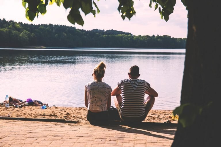 couple sitting on waters edge