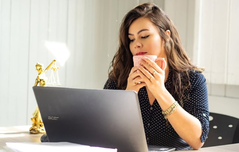 woman looking at computer picking an ETF